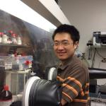 Jiayong Gan working in the glove box.
