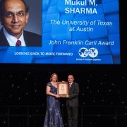 Dr. Sharma receiving the award at the ATCE2017 Annual Awards Banquet